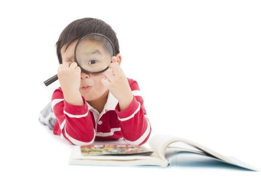 surprised kid looking through from magnifying glass