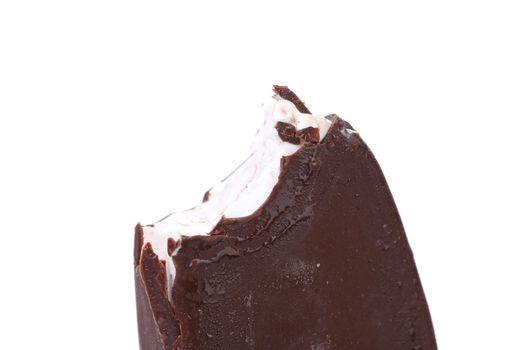 Bitten ice cream on stick.