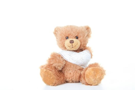 accident concept teddy with bandage