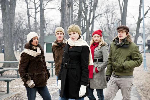 Group of diverse young people outdoors in winter park