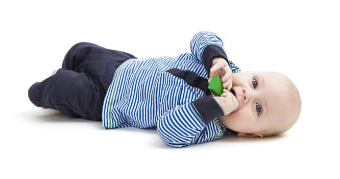 vertical image of toddler lying on floor. isolated on white background