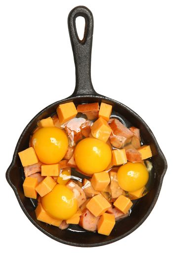 Raw Eggs, Cheese and Sausage in Cast Iron Skillet