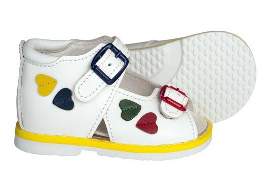 white children's sandals on a white background