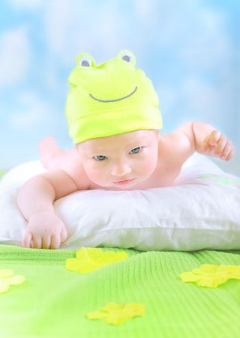 Little baby in frog costume