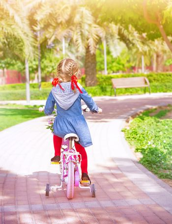 Little girl on the bicycle