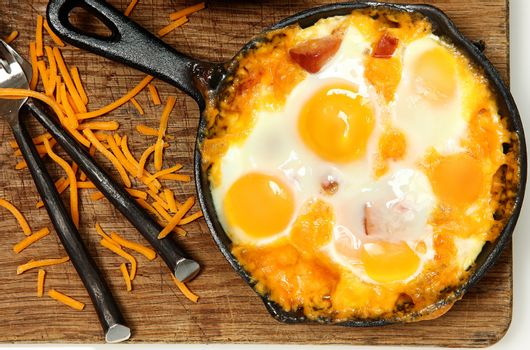 Skillet Baked Eggs and Sausage with Cheese