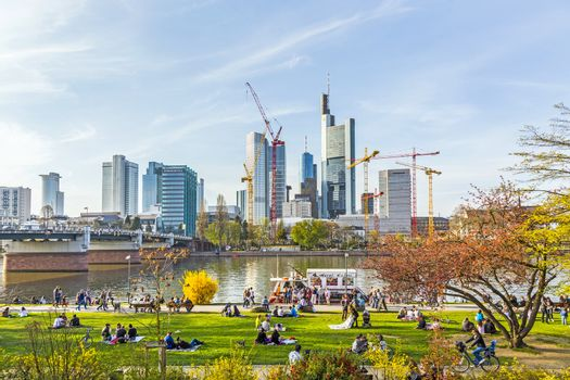 people enjoy the first warm spring day in Frankfurt