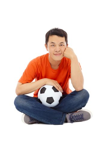 young man sitting and hold a soccer