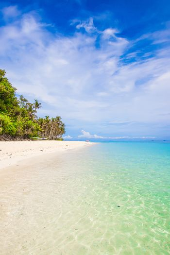 Nobody on beauty white beach with turquoise water and blue sky