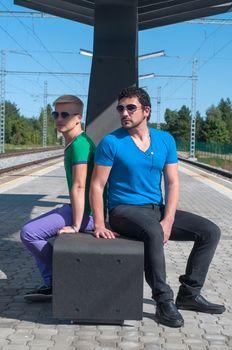 Shot of two handsome guys sitting on platform