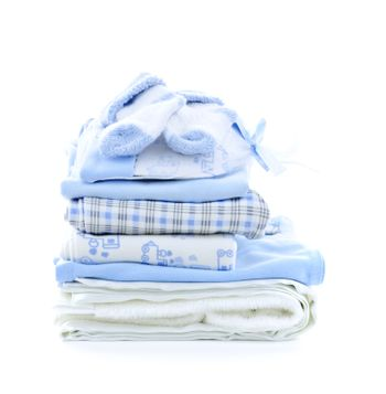 Stack of blue infant clothing for baby shower isolated on white background