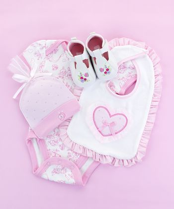 Pink infant girl clothing for baby shower