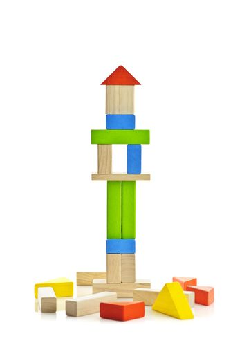 Tower of wooden building block toys isolated on white background
