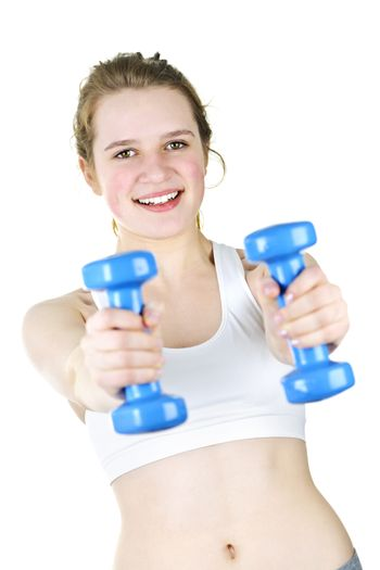 Healthy young woman working out with weights for fitness exercise