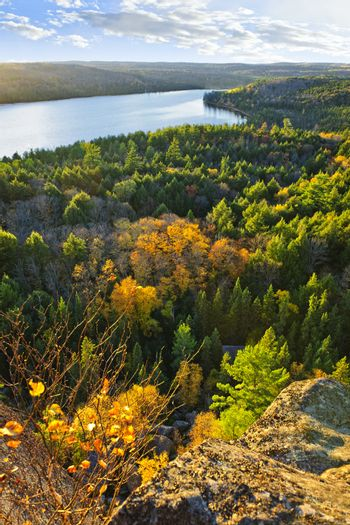 Lake and fall forest with colorful trees from above in Algonquin Park, Canada