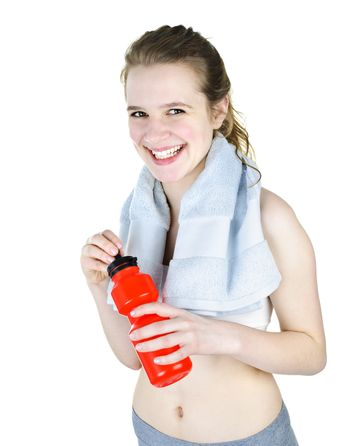 Happy fit young woman ready for workout with towel isolated on white