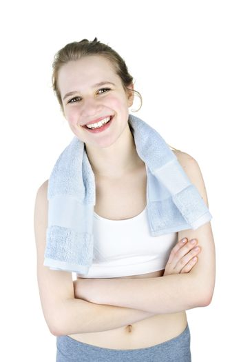 Happy fit young woman after workout on white background