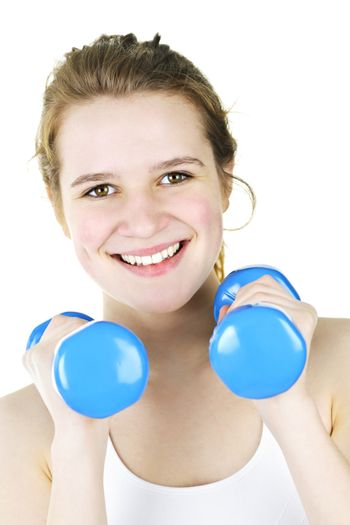 Portrait of smiling fit young woman working out with weights for fitness exercise