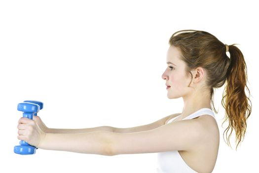 Determined healthy fit young woman lifting weights for fitness exercise