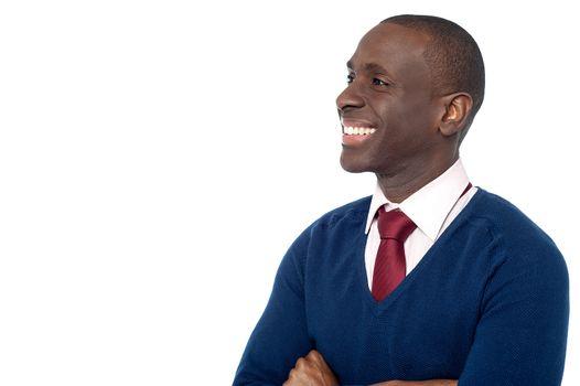 Cheerful corporate guy looking away