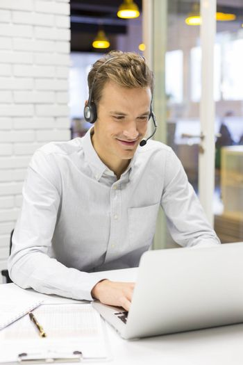 Male calling computer desk video conference
