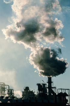 Smoking chimney  at sunset