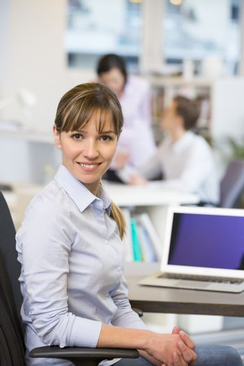 Female business laptop desk start-up colleagues background
