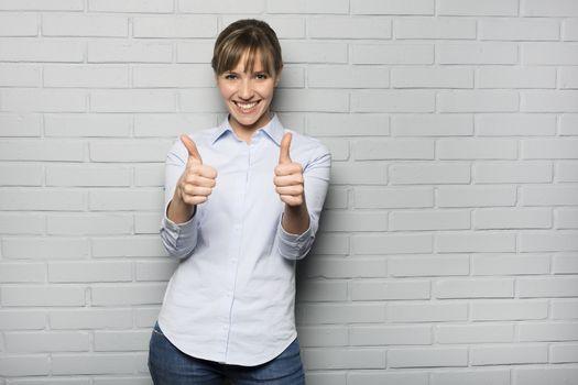 Female casual cheerful studio  gesture grey background