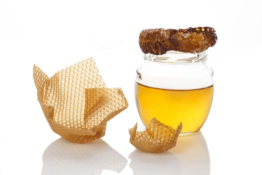 Organic honey with honey comb and honey cups isolated on white background. Natural healthy sweetener.