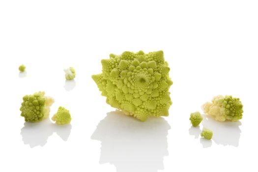 Romanesco broccoli pieces isolated on white background. Culinary healthy fresh vegetable eating.