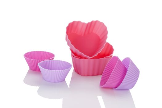 Pink and purple baking forms isolated on white background. Baking, contemporary minimal style.