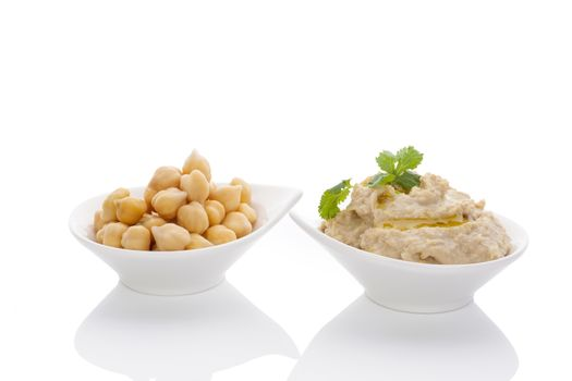 Chickpeas and hummus in bowls isolated on white background. Culinary eastern cuisine.