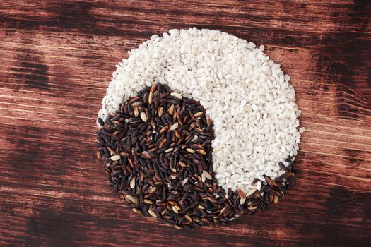 White and wild rice forming Yin Yang Symbol. Healthy balanced cooking. Traditional chinese culture.