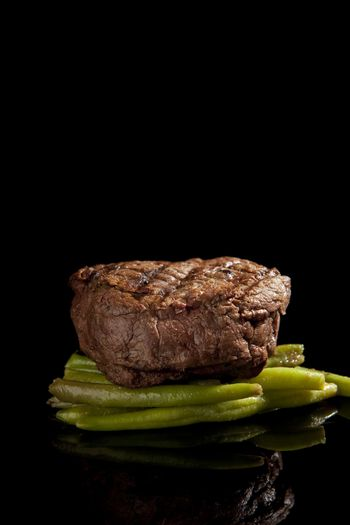 delicious beef steak on black background
