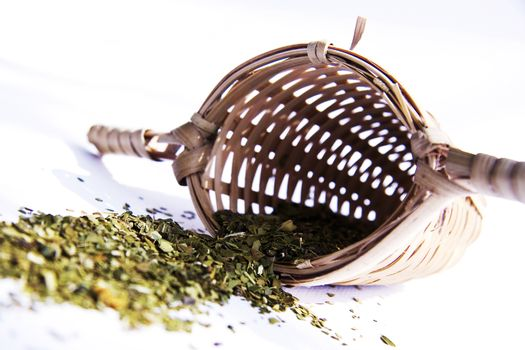 Bamboo tea strainer whith green tea studio shot