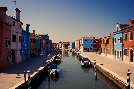 Surreal colorful houses on Burano island in Venice.