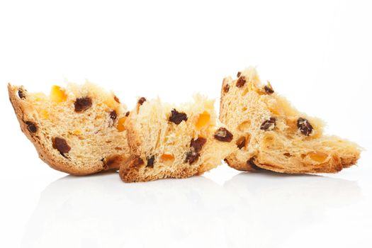 Panettone fruit cake pieces isolated on white background. Traditional italian christmas cake.