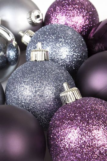 Purple and silver christmas ball background. Festive shiny xmas decoration.