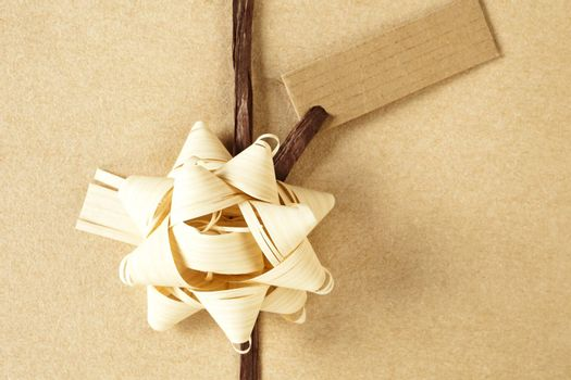 Beautifully naturally wrapped gift with label and copy space.