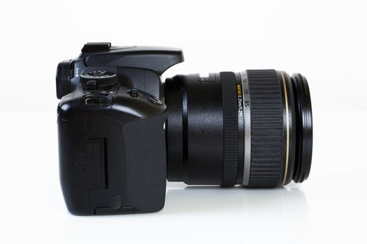 Digital Single Lens Reflex Camera on white background.