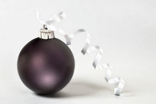 Christmas ball with ribbon on white background.