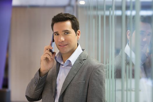Male smiling mobile phone business looking camera office