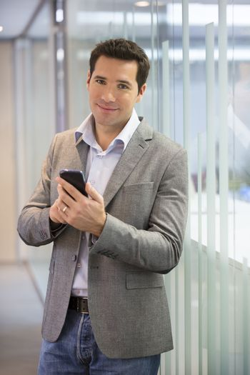 Male smiling mobile phone business looking camera