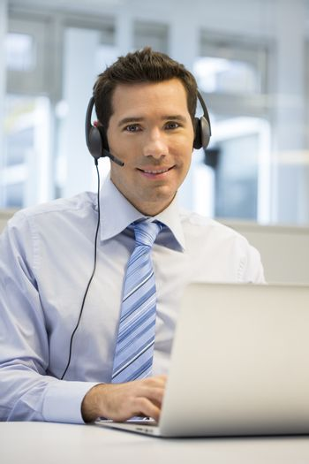 Male smiling business talk computer laptop