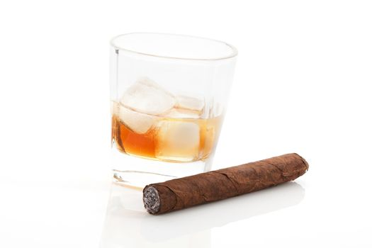 Whiskey and cigar on white.