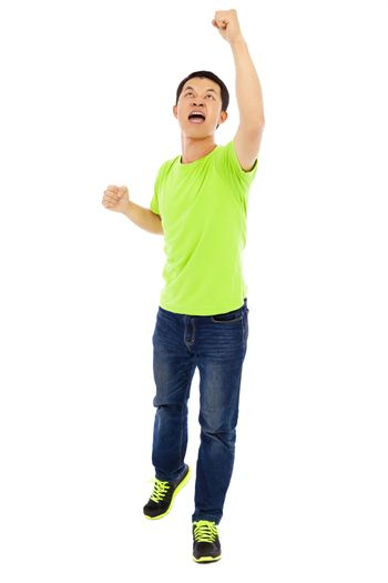 young man raise hands to yell win