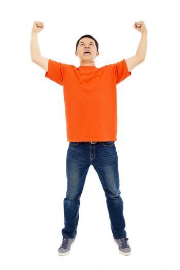 screaming young man raises hands to celebrate