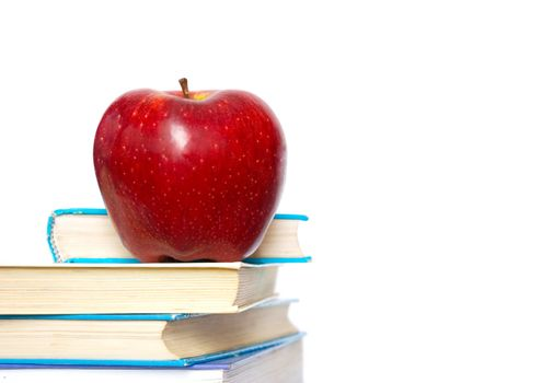 Red apple and stack of books for school