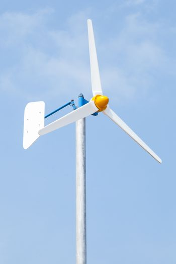 Wind turbine to produce electricity with wind. Installed alongside the sea.