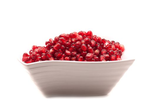 Pomegranate seeds close-up with frost